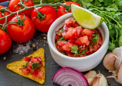 Salsa sauce and ingredients - tomates, onion, chili, garlic, lime